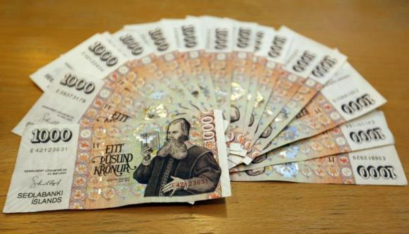 An illustration picture shows Iceland banknotes of one thousand Krona in Reykjavik