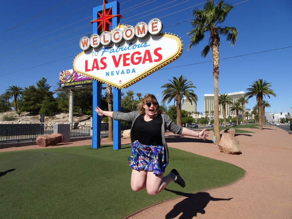 Jumping for joy in front of the Las Vegas sign