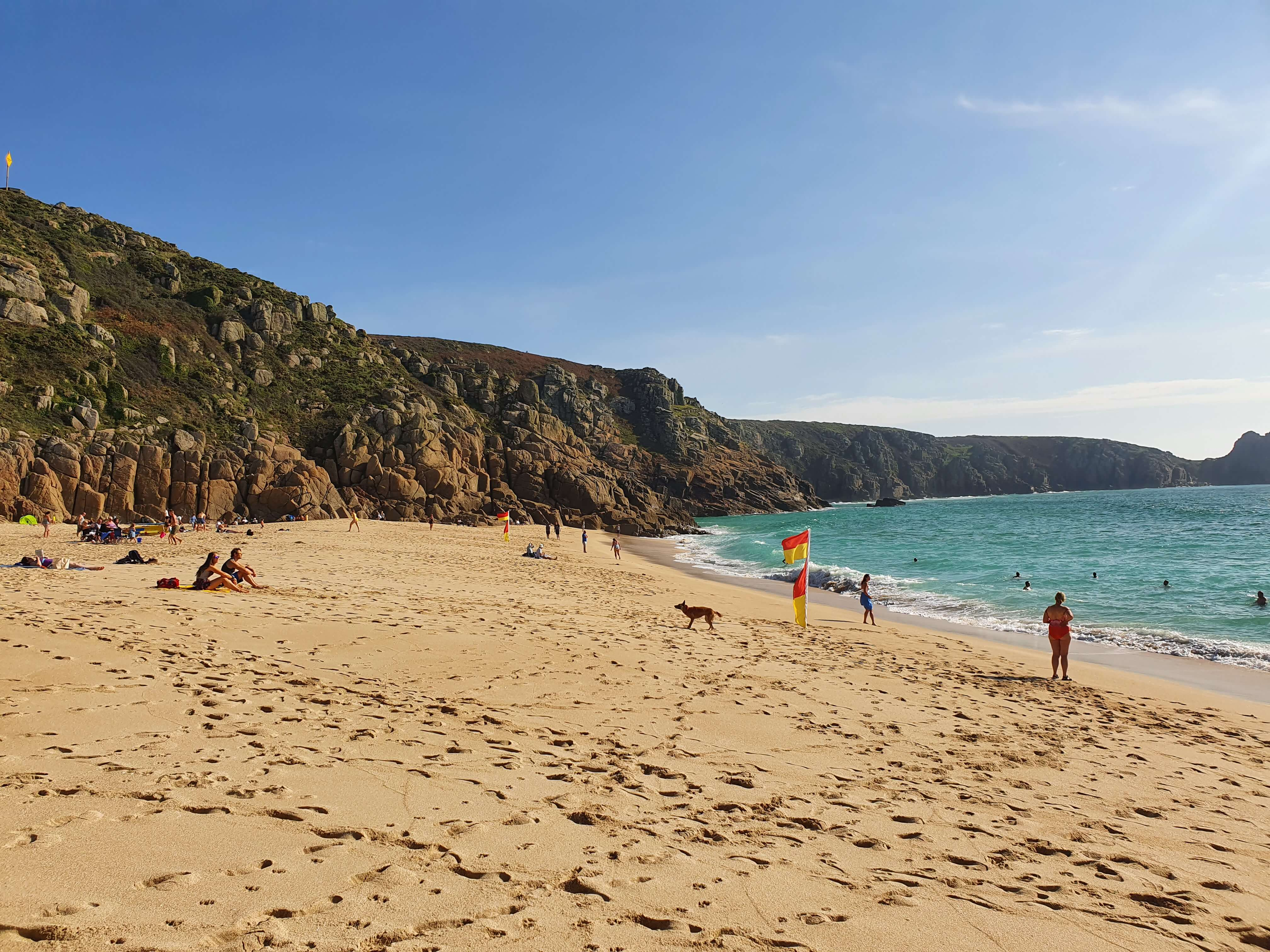 The beautiful Porthcurno Beach, with white sands, turquoise sea and rocky cliffs